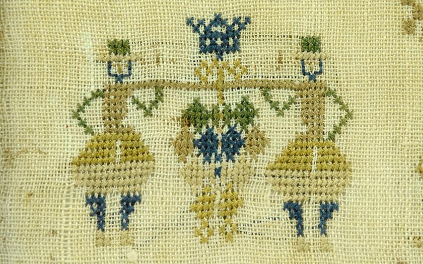 detail merklap druiventros-dragers